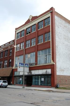 four story brick commercial storefront