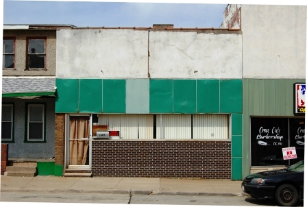 one story storefront with replacement facade
