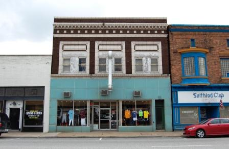 two story commercial building in brick with classical details